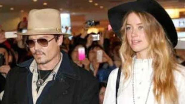 Report: Amber Heard Seeks Restraining Order Promo Image