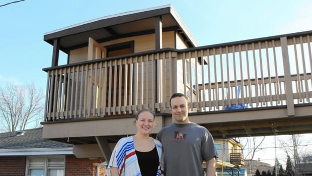 Joseph and Margaret Solomon standing in front of their treehouse