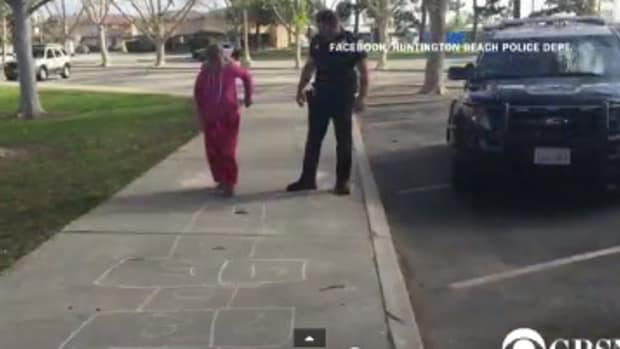 Cop's Good Deed For Homeless Girl Goes Viral (Video) Promo Image