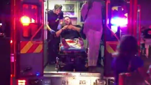 Dozens Burned At Tony Robbins Fire-Walking Event (Video) Promo Image