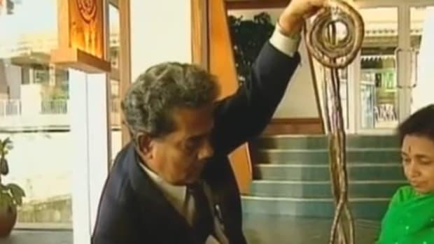 Shridar Chillal holding up long fingernails