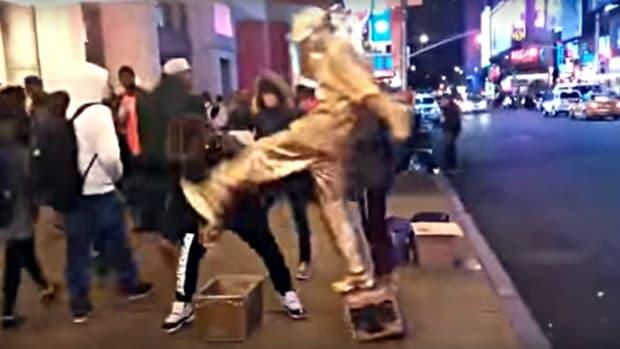 street performer kicks robber in face