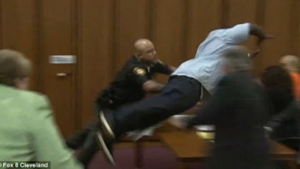 Murder Victim's Father Attacks Killer In Court (Photos) Promo Image