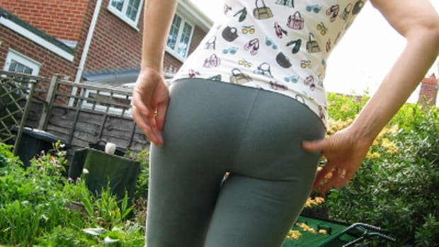 a woman wearing leggings with a T-shirt