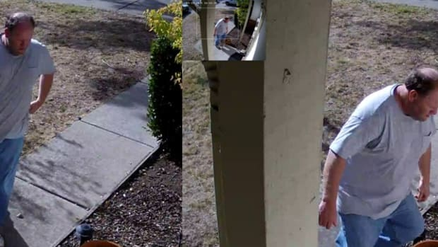 Screenshot, man taking package from porch