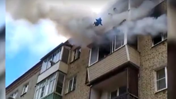 Family Jumps From Fifth Floor During Fire (Video) Promo Image