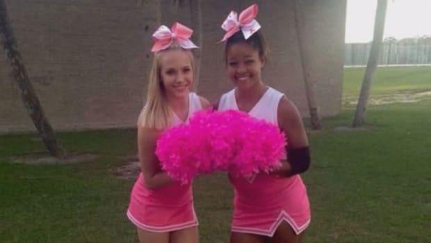 Tampa Bay Tech cheerleaders in pink uniforms