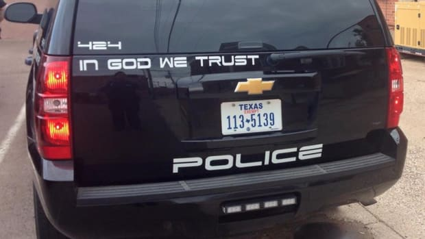 """""""In God We Trust"""" On Childress, Texas, Police Car."""