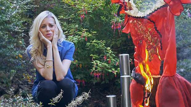 Woman watching Halloween costume go up in flames
