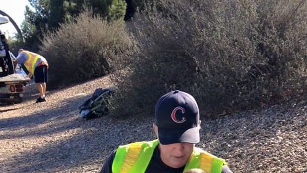 Photo Of Firefighter's Actions At Scene Of Violent Crash Goes Viral (Photo)  Promo Image