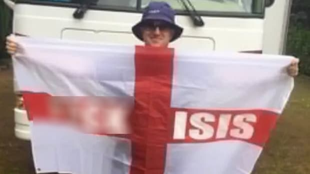 Man Banned From Soccer Games For Waving Anti-ISIS Flag Promo Image