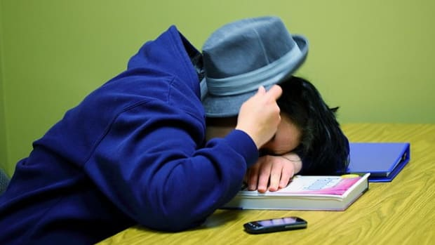 A college student sleeping in class.