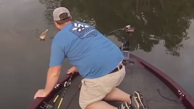 Fisherman Spots Something Unexpected While Fishing On River, Reacts Swiftly (Photo)  Promo Image