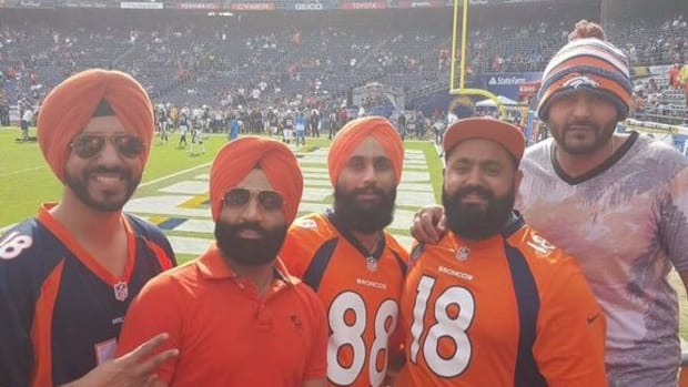 Verinder Malhi and friends wearing turbans at football game