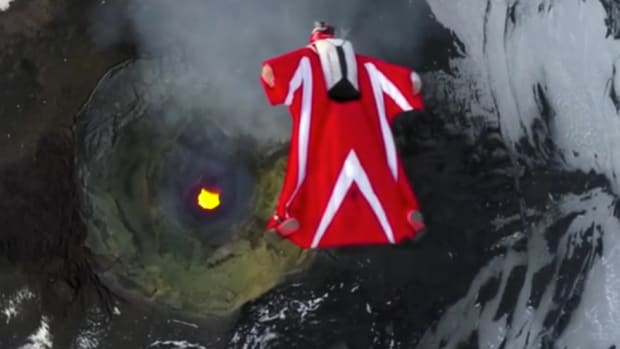 Woman Flies In Wingsuit Over Active Volcano (Video) Promo Image