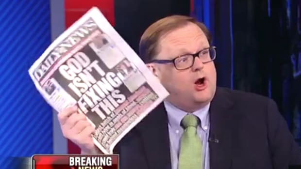 Todd Starnes holding up New York Daily News paper