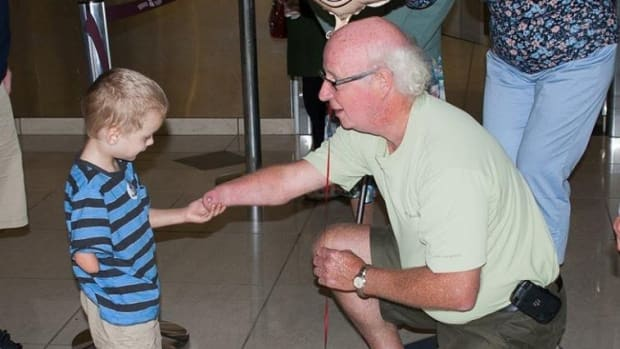 Grandfather And Grandson Bond Over Missing Hands.