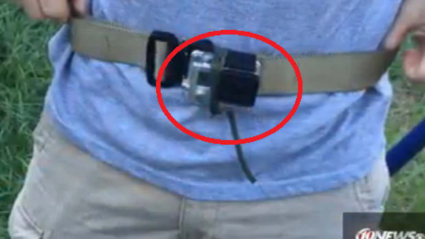 GoPro strapped around man's waist