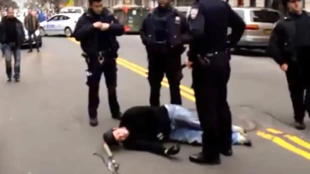 Unmarked Cop Car Hits Biker, Crowd Reacts (Video) Promo Image
