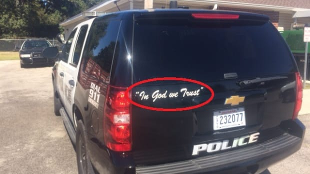 Police Cruiser with 'in god we trust' decal on it