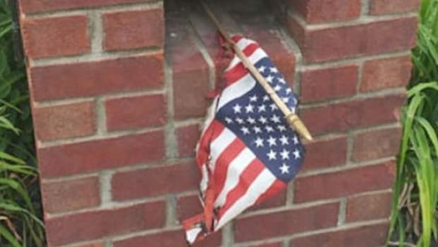 Officer Stands Up To American Flag Burner, Makes Disturbing Discovery On His Property (Photos) Promo Image
