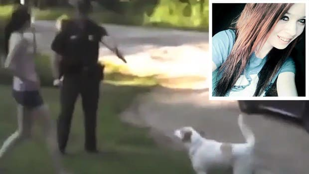 Woman Blocks Cop From Shooting Dog, Is Arrested (Video) Promo Image