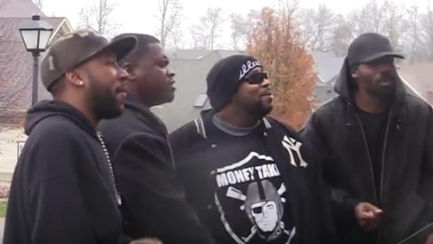 black men singing Christmas carols
