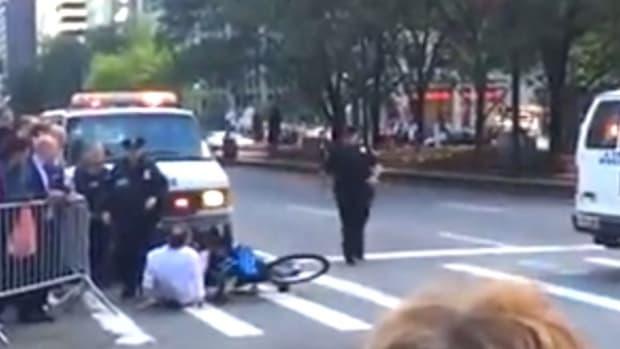 Cops Tackle Cyclist Near Obama's Motorcade (Video) Promo Image