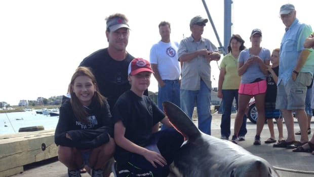Mike Evensen and kids posing with giant shark