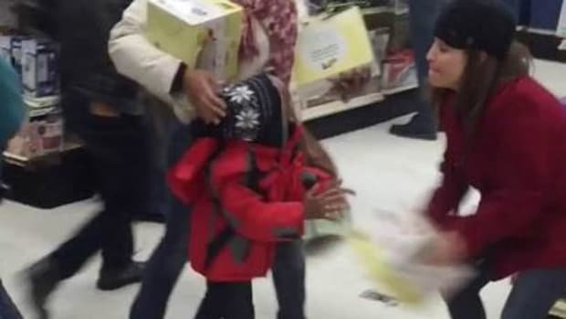woman stealing steamer from child's hands