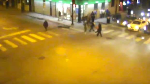 Assault Victim Run Over By Cab, Bystanders Watch (Video) Promo Image