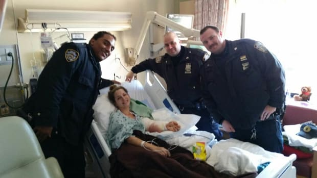 NYPD Officers With The Car Crash Victim.