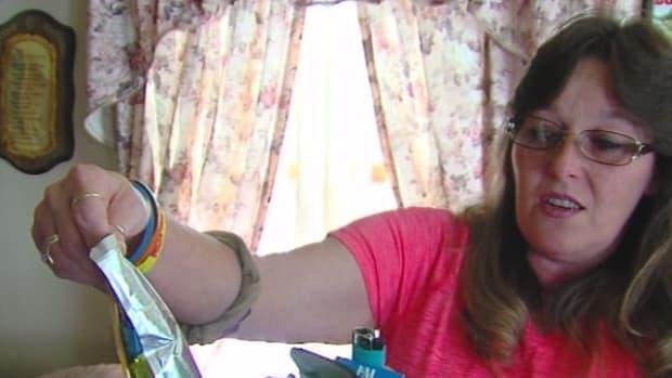 Sherry Mihm holding up moldy capri sun juice pouch