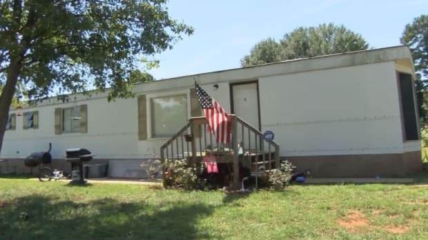 American flag flies outside Teresa Greene's mobile home