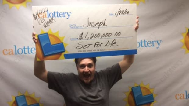 Joseph Carillo with $1.2 million lottery check