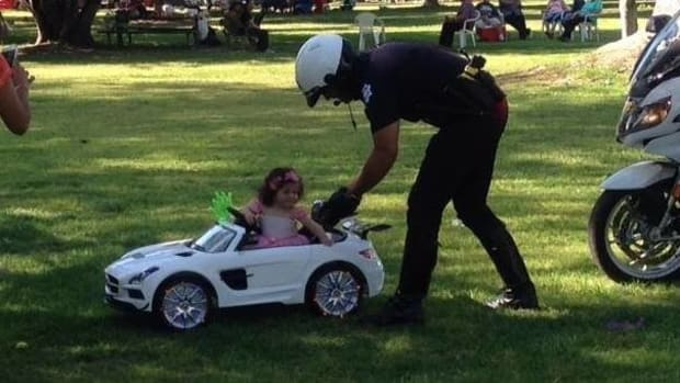 Officer Conducts Pretend Traffic Stop For Toddler  Promo Image