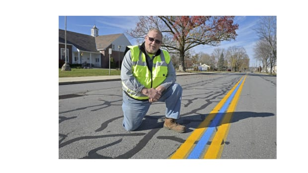 Community Paints Blue Stripe To Honor First Responders Promo Image