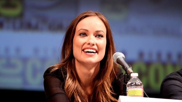 Olivia Wilde Posts Image Of Baby Clothes, Draws Ire (Photo) Promo Image