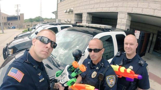 Police Officers Pull Guns On Kids - Water Guns (Video) Promo Image