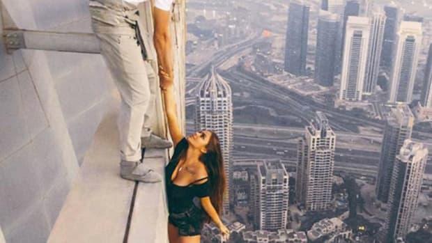 Model Criticized For Dangerous Photo Shoot (Video) Promo Image