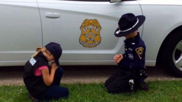 Police Officer's Children Pray For His Safety (Photo) Promo Image