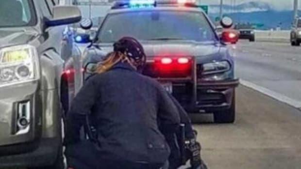 Officer Kneels To Change Tire, Gets Big Surprise Promo Image