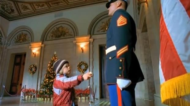 Guard Ignores Boy, Then People Notice What He's Doing With Left Hand  Promo Image