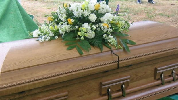 Man Asks To Be Buried With Money, Wife Complies Promo Image