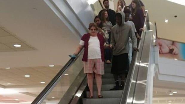 Mom Shocked To See Teen Helping Grandma Down Escalator  Promo Image