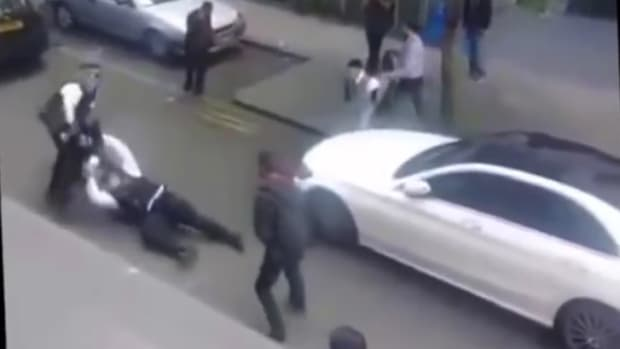 Two Officers Without Guns Hold Off Group Of Men (Video) Promo Image