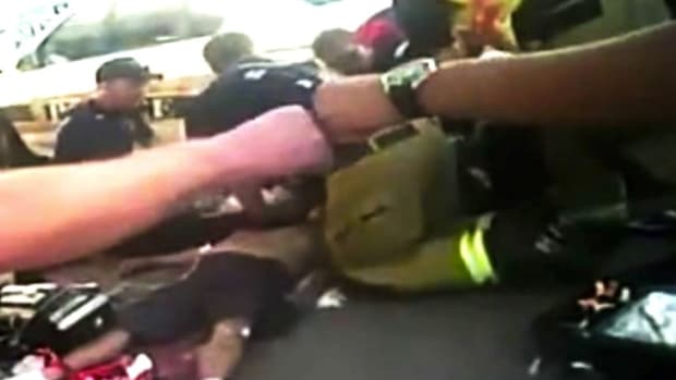 New Mexico Officers Exchange Fist Bumps After Man Dies (Video) Promo Image