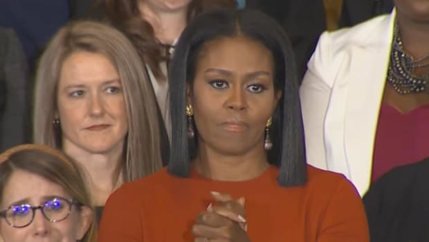 Michelle Obama Unsmilingly Looks On At Trump (Photos/Video) Promo Image