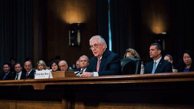Tillerson Backs Trump's Second Travel Ban Promo Image