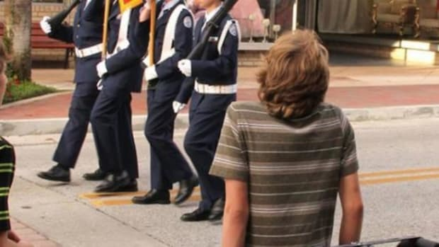 Man Snaps Photo Of Teen On Street Corner, Goes Viral As People Notice What's In Street Promo Image